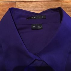 Theory Rich Purple Blouse, Medium Gorgeous Theory short sleeve blouse, rich vibrant purple color. Size Medium. Perfect condition . wore once . no damages , freshly dry cleaned. flat measurements : bust 18 inches. There is stretch in the fabric. Length is 25 inches from highest point of shoulder to bottom of blouse. Beautiful pleated details around the waist which gives this blouse beautiful character. Smoke free closet. 😊 Theory Tops Blouses