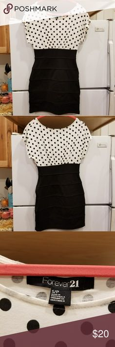 Forever 21 Polka Dot Dress This gorgeous dress makes you feel so good! It's bottom skirt is form fitting and the top is more loose for a balanced look. It was great to wear to school events or to the office! Enjoy! Forever 21 Dresses Mini