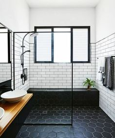 Midcentury Modern Bathroom Tile Ideas Midcentury bathroom where white subway tiles meet black hexagon tiles.Midcentury bathroom where white subway tiles meet black hexagon tiles. Modern Bathroom Tile, Bathroom Renos, Bathroom Interior, Bathroom Remodeling, Bathroom Black, Bathroom Designs, Bathroom Vanities, Bathroom Layout, Bathroom Cabinets