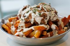 Greek poutine comes topped with pulled pork and feta cheese ($7.50) at The Greek on King West