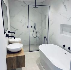 Modern bathrooms incorporate large vanities, Walk In Showers, freestanding baths, shower niches and black tapware this bathroom is one of the most bat… - Marble Bathroom