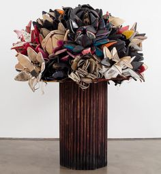Willie Cole. Shoe Bouquet. 2009. I picked this artist because I was impressed with the way he can use found objects and completely transform them. The way the artist manipulated the shoes and sorted them by color to resemble flowers makes it obvious that he has practiced with shoes many times,