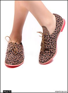 Leopard Print Oxfords. Need I say more? Just in case…these shoes feature a red sole and a suede leopard print upper. http://www.edgeofurge.com/boutique/shoes/womens/flats/mini_shoes.php#thumb
