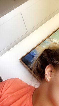 rook, conch, & tragus piercings with triples.