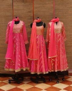 Bandhini Anarkali suit with gotapatti work on the yolk and gota border. Comes with matching churidar and dupatta. Available in different prints and colors of ba Anarkali Dress, Pakistani Dresses, Indian Dresses, Indian Outfits, Anarkali Suits, Punjabi Suits, White Anarkali, Indian Party Wear, Indian Wear