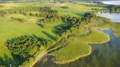 Jezioro Dargin skąpane w słońcu, Piękne Mazury, inwestycje w grunty, działki rolne