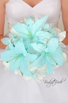 Tiffany blue tiger lily bouquet with silver leaves Blush Wedding Colors, Blue Beach Wedding, Blue Wedding Flowers, Bridal Flowers, Lily Bouquet Wedding, Beach Wedding Bouquets, Lily Wedding, Turquoise Wedding Bouquets, Turquoise Weddings