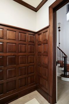 Bevelled dark wood wainscoting