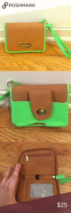 Unique Steve Madden wristlet w/iPhone holder Lime green and tan design makes this super bright and unique. Small nicks on the leather exterior but other than that, mint condition. Outside buckle pocket fits a smaller iPhone. (Like a 5 and smaller). Strap is removable. Steve Madden Bags Clutches & Wristlets