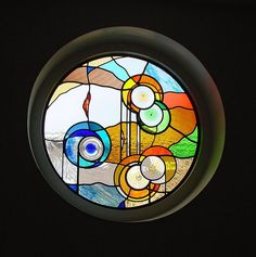 a round stained glass panel - design and maker Roel Hildebrand. Stained glass studio Alkmaar - The Netherlands.