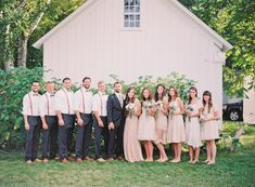 ideal wedding dress for bridesmaids and groomsmen. navy dress pants, boots, suspenders and bow ties for groomsmen. mismatchy cute blush and cream dresses for bridesmaids -- fall wedding  Photography: Michelle March - michellemarch.com  Read More: http://www.stylemepretty.com/2014/03/06/fall-wedding-at-cherry-basket-farm/