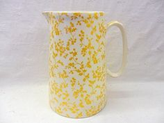 Golden Holly 4 pint jug by Heron Cross Pottery. Heron Cross Pottery http://www.amazon.co.uk/dp/B015YKFQ7M/ref=cm_sw_r_pi_dp_yojWwb0H2PG8Y