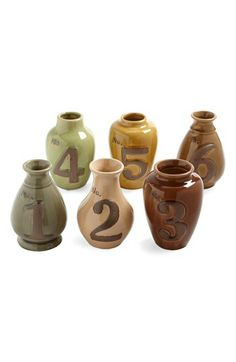 centerpiece vases + table numbers in one!