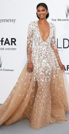 Chanel Iman wore an elegant tulle princess gown with a plunging neckline at the 2015 Cannes amFar gala