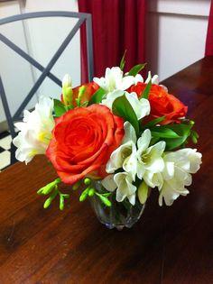 small posy bouquet: white freesia, orange roses