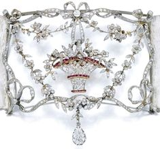 """All tied up in a nice bow.  Belle epoque diamond and ruby plaque-de-cou from 1905. A plaque-de-cou was a variation of the """"collier de chien"""" that was popular in the late 1800's and early 1900's. Collier de chien (or """"dog collar"""") was just what choker-style necklaces were called. A plaque-de-cou is a collier de chien featuring a large rectangular or square plaque suspended on a ribbon or strands of pearls."""