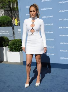 Jennifer Lopez Cutout Dress - Jennifer Lopez was retro-sexy at the NBCUniversal Upfront in a long-sleeve white turtleneck mini dress with a series of cutouts down the bodice.