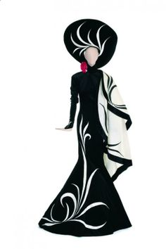 """BOB MACKIE ERTE STYLE GOWN Worn on the February 29, 1976 episode of """"The Sonny & Cher Show"""" during Cher's performance of """"Solitaire."""" Elaborate black velvet period gown with matching hat and attached white cape designed by Bob Mackie."""
