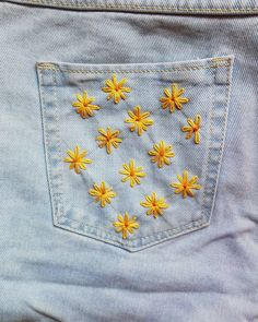 We love how these small, hand-embroidered yellow flowers make this pair of jeans so fresh! Hand embroidered by using yellow and orange DMC embroidery threads. Simple Embroidery Designs, Embroidery On Clothes, Couture Embroidery, Embroidered Clothes, Hand Embroidery Stitches, Diy Embroidery, Embroidery Patterns, Diy Embroidered Jeans, Denim Jacket Embroidery