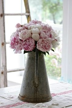 peonies in a vintage metal container. @Ashley Brown love these colors and the vintage metal container!