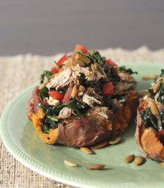 Grilled Chipotle Chicken Stuffed Sweet Potato with bell pepper, kale, and toasted pumpkin seeds.