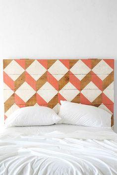 Geometric headboard to brighten up a white room.