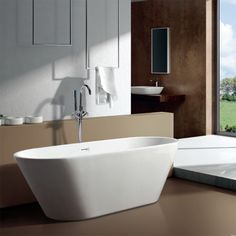The Bari Freestanding Bath is a stunning addition to a modern bathroom. Bath comes with built in overflow and waste and is perfectly complimented by one of our stylish freestanding taps. If a more conventional bath filler or bath shower mixer is re Lugano, Clawfoot Tub Faucet, Bath Tub, Bath Room, Bathtub Surround, Modern Bathtub, Modern Bathroom, Master Bathroom, Furniture