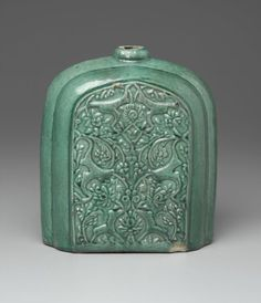 Pilgrim Flask, early 17th century. Ceramic; earthenware, molded and covered with a green glaze, 8 11/16 x 6 11/16 x 4 1/8 in. (22 x 17 x 10.5 cm). Brooklyn Museum, Gift of Mr. and Mrs. Frederic B. Pratt, 36.942. Creative Commons-BY (Photo: Brooklyn Museum, 36.942_front_PS2.jpg)