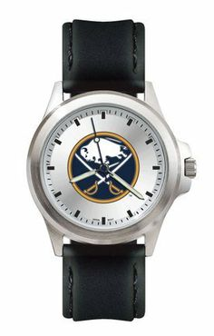 "Buffalo Sabres NHL Men's Fantom Watch by Logo Art. $48.08. Case: 1 5/8"" wide by 1 3/4"" tallDial diameter: 1 1/16""Overall length: 10 1/4""Man's water resistant Buffalo Sabres NHL sport watchSunray silver tone dial ring with notched silver tone dimensional dial ringLuminous hour and minute hands with second hand in team colorBrushed chrome finish alloy case and stainless steel backSoft padded stitched edge leather strap with stainless steel buckleMiyota Japanese quartz m..."