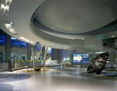 """Cullman Hall of the Universe, Hayden Planetarium, New York. Above is the bottom of the great sphere containing the planetarium theater and the Big Bang Theater. The Willamette meteorite is also prominent in this area which focuses on the Solar System. (Image: Jay Rosenblatt) Mona Evans, """"Rose Center and Hayden Planetarium"""" http://www.bellaonline.com/articles/art183413.asp"""