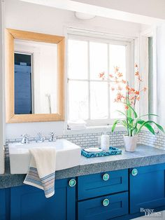 Give cabinetry a playful edge with colorful oversize knobs.