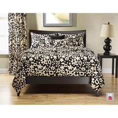 I've been on the hunt for a black and white bed something (duvet, quilt, comforter)...this is cute.  Maybe too cute for Kevin.