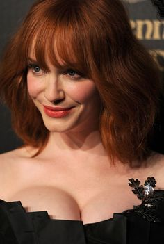 Stunning Christina Hendricks ... She makes me wanne be rich and powerful!... A poll of female readers taken by Esquire magazine named Hendricks -the sexiest woman in the world-
