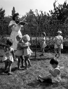 HUNGARY. Budapest. 1948. A state-run kindergarten which receives UNICEF milk supplies.  Some of the 90 children of workers in the textile factory of Fesus Fono, in the garden of the factory kindergarten, located in the house of the former owner of the factory. David Seymour