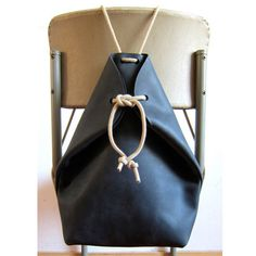 Minimal handmade black leather rucksack with contrasting rope