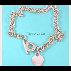 TIFFANY & CO Silver Heart Tag Toggle Necklace This is an authentic TIFFANY & CO Sterling Silver Heart Tag Toggle Necklace. This stunning necklace is sterling silver with a toggle clasp and heart tag charm . This is a marvelous necklace with a distinctive look, from Tiffany & Co! Tiffany & Co. Jewelry Necklaces