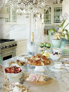 Gorgeous high tea spread on the most beautiful marble kitchen bench.