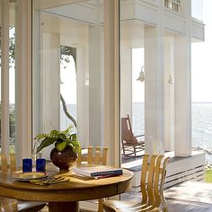 Muntinless Sliding Doors  Article by Rob Martin    5 of 6  »  View all  Glass Sliding Doors    Muntinless sliding doors give the illusion that the living room flows right through the open pavilion to the river's edge.