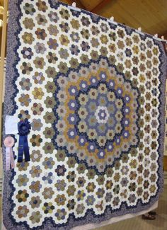 """""""Sara's Hexagon Medallion"""" won the ribbon for the Traditional category.  It is hand pieced (but not by the English paper piecing method) and hand quilted."""