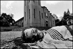 "Magnum Photos Photographer Portfolio Gilles Peress RWANDA. Nyarubuye. 1994. A victim of tribal violence. Over 1000 refugees were slain in this seminary by Hutu militias known as ""interahamwe"