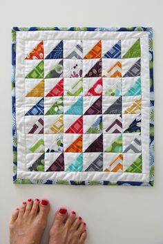 or by my feet...mini quilt tutorial - love triangles in brights on a white background