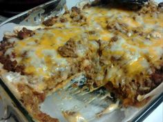 Creamy Burrito Casserole Ingredients: 1 lb ground beef or 1 lb ground turkey 1/2 medium yellow onion, chopped 1 (1 1/4 ounce) package taco seasoning 6 large flour tortillas 1 (16 ounce) can refrie...