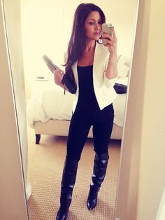 All black and white blazer with boots and clutch