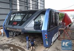 China builds a futuristic bus that soars above cars and beats traffic jams