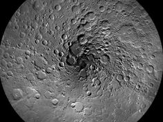 """""""This image of the moon's north polar region was taken by the Lunar Reconnaissance Orbiter Camera, or LROC. One of the primary scientific objectives of LROC is to identify regions of permanent shadow and near-permanent illumination. Since the start of the mission, LROC has acquired thousands of Wide Angle Camera images approaching the north pole. From these images, scientists produced this mosaic, which is composed of 983 images taken over a one month period during northern summer. This…"""