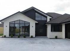Sturdy and Economical Brick House Design Ideas - White Exterior Houses, House Paint Exterior, Dream House Exterior, Exterior House Colors, House Ideas Exterior, Exterior Homes, Black Exterior, Grey Brick Houses, Modern Brick House