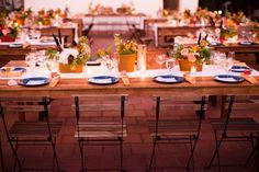 Wedding reception tables with blue camping plates - photo by Acqua Photo http://ruffledblog.com/san-clemente-summer-camp-wedding