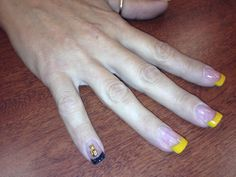 yellow and black acrylic tipswith gold cat decal