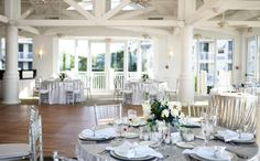 Silver table overlay, silver chargers, diamond napkin rings, wedding reception with silver chiavari chairs, beach wedding. Elegant, glamorous