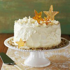 This pistachio cake with white chocolate frosting is delicious! Decorate the frosted cake with any decorations to perfectly match the theme you want for the cake. This yummy cake recipe is tasty and a great recipe for any party or celebration!
